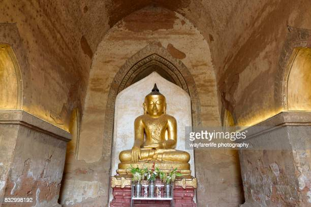 Statue of Buddha in golden color inside a temple, Mandalay, Myanmar
