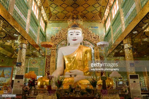Statue of Buddha in golden color inside a temple, Myanmar
