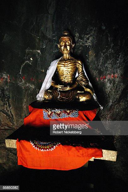 A statue of Buddha in the Dungeshwari caves July 25 2005 in Bodhgaya India The statue shows Buddha during a period of fasting and meditation in the...