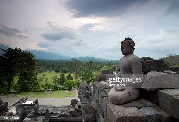 A statue of Buddha on the Borobudur temple in central Java.