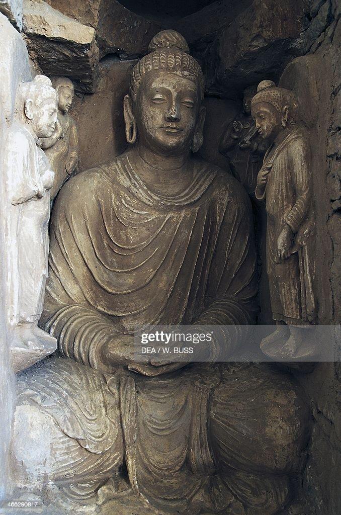 Statue of Buddha ruins of the Jaulian monastery Taxila 5th century BC