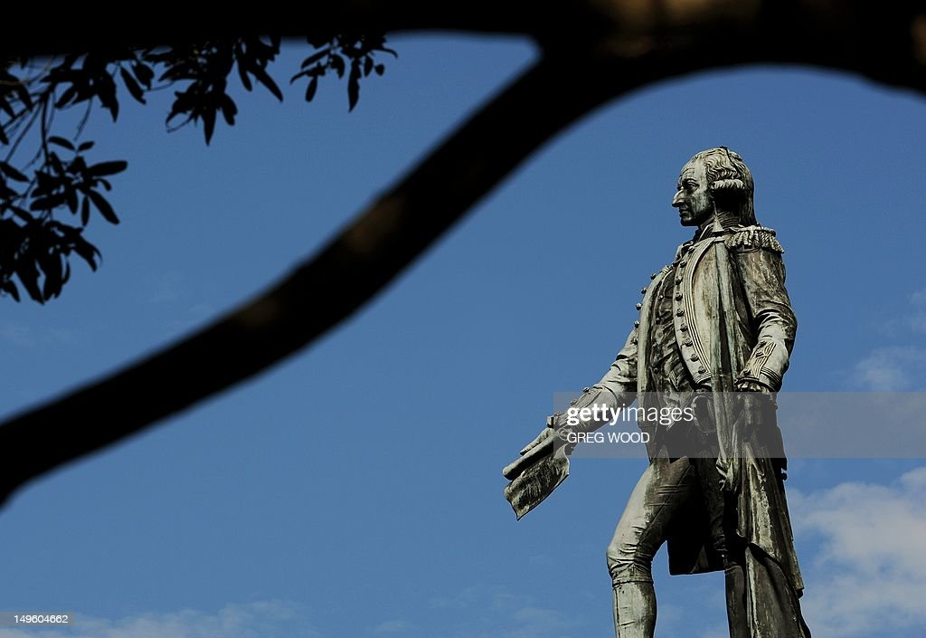 A statue of Captain Arthur Phillip (R), the first governor of Australia's New South Wales state (from 1788 - 1792), is shown framed by tree branches in Sydney's Royal Botanic Garden on August 1, 2012. The statue was unveiled in 1897 and sits in what is Australia's oldest botanic garden and scientific institution. AFP PHOTO / Greg WOOD