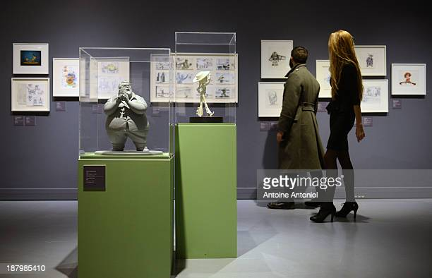A statue of character Al from the film Toy Story 2 sit on display at 'Pixar 25 years of Animation' exhibition on November 14 2013 in Paris France The...
