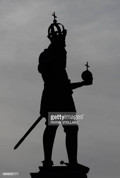 A statue of Charlemagne is seen in front of the townhall of Aachen western German on January 28 on the 1200th anniversary of his death STOLLARZ