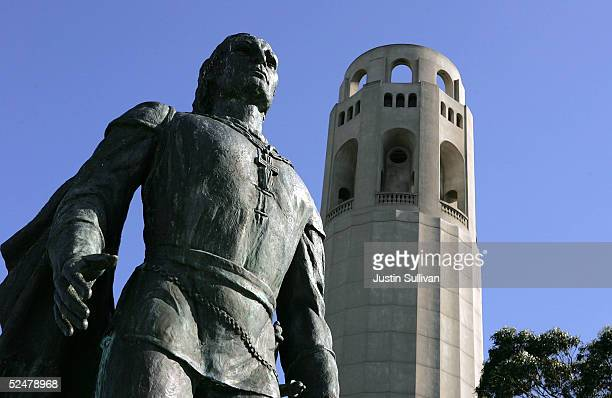 A statue of Christopher Columbus is seen next to Coit Tower March 25 2005 in San Francisco California San Francisco's 49Mile Scenic Drive was opened...