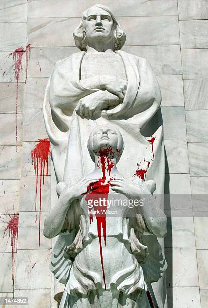 A statue of Christopher Columbus was vandalized with red paint at Union Station October 14 2002 in Washington DC The fountain and statue were covered...