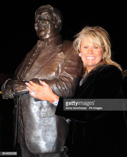 A statue of comedian Les Dawson is unveiled by his widow Tracy Dawson at St Annes Pier Lytham St Annes Lancashire