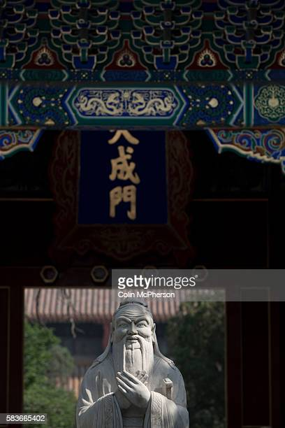 A statue of Confucius at the Confucius Temple and Guozijian in Beijing China The complex was first built during the Yuan Dynasty and followed the...