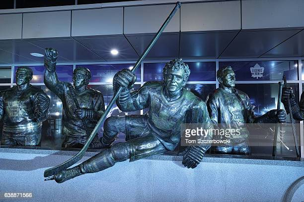 A statue of Darryl Sittler of the Toronto Maple Leafs on Legends Row next to Tim Horton and Borje Salming and Ted Kennedy in front of the Air Canada...