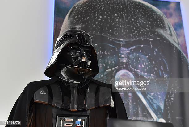 A statue of Darth Vader is displayed at the preview of the 'Star Wars Vision' exhibition in Tokyo on April 28 2015 Star Warsrelated objects will be...