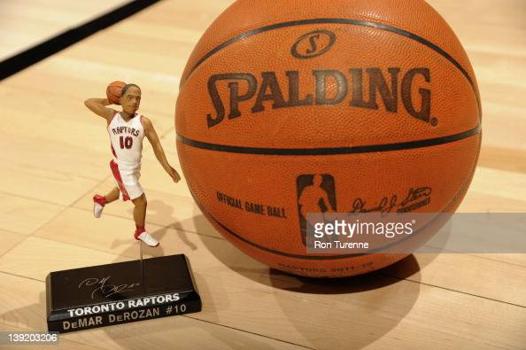 A statue of DeMar DeRozan of the Toronto Raptors is arranged next to a Spalding basketball before a game against the Charlotte Bobcats on February 17...