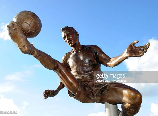 A statue of Dennis Bergkamp after being unveiled before the Barclays Premier League match at the Emirates Stadium London