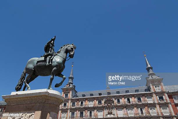 Statue of Felipe III and the painted Casa de la Panaderia in the Plaza Mayor in Madrid