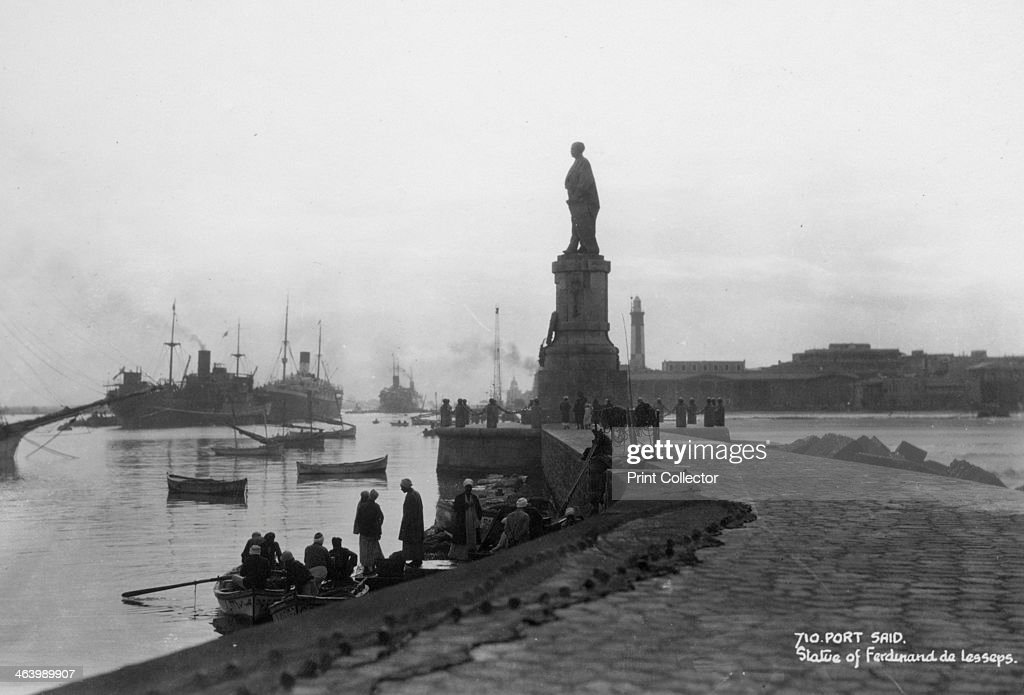 Statue of Ferdinand de Lesseps Port Said Egypt c1920sc1930s A French diplomat and entrepreneur de Lesseps built the Suez Canal to enable shipping to...
