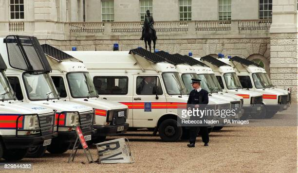 A statue of Field Marshall Viscount Wolseley looks over Metropolitan police vehicles parked at Horse Guards after the West End was evacuated due to...