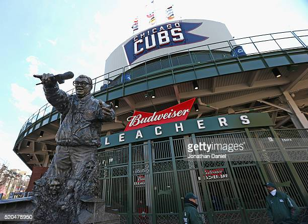 A statue of former broadcaster Harry Caray has been relocated to the bleacher entrance behind the outfield before the home opener between the Chicago...
