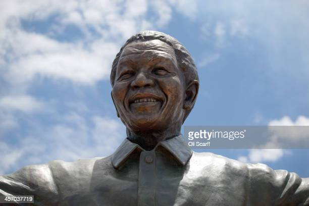 A statue of former South African president Nelson Mandela is unveiled at the Union Buildings on December 16 2013 in Pretoria South Africa South...