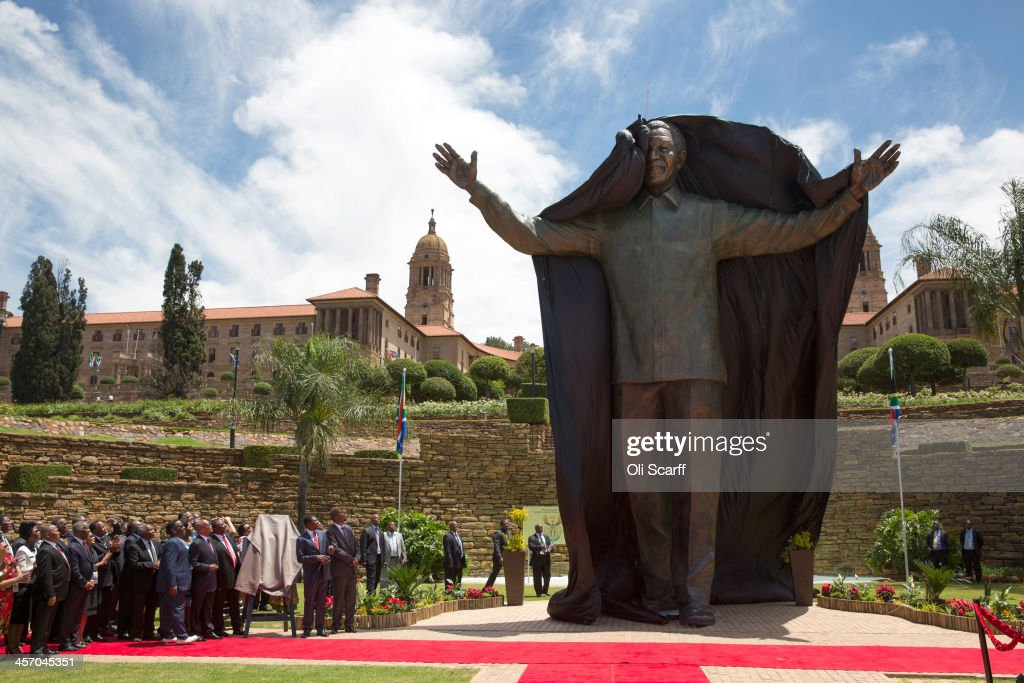 A statue of former South African president Nelson Mandela is unveiled at the Union Buildings on December 16, 2013 in Pretoria, South Africa. South African president Jacob Zuma unveiled a 9 meter bronze statue of former South African president Nelson Mandela as part of the Day of Reconciliation celebrations.