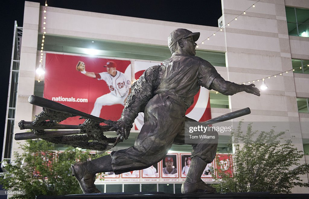 A statue of former Washington baseball player Josh Gibson, appears near the centerfield gate at Nationals Park. Current National Adam LaRoche appears on a banner in the background.