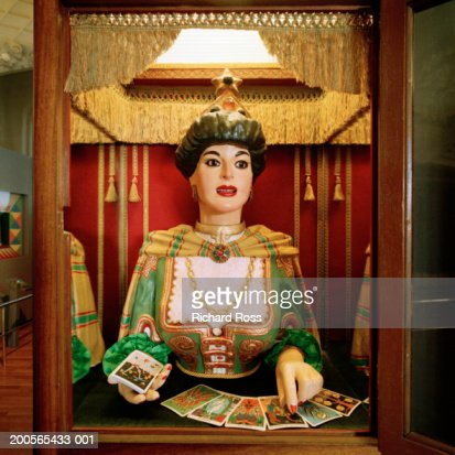 Statue of fortune teller and tarot cards