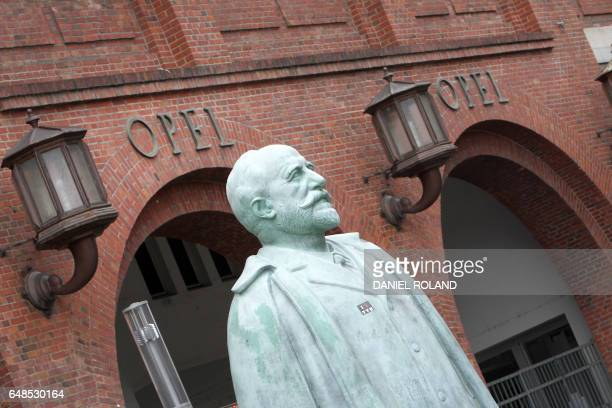 A statue of founder of car maker Adam Opel is pictured at the company's former headquarter in Ruesselsheim Germany March 6 2017 / AFP PHOTO / Daniel...