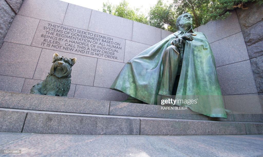 A statue of Franklin Delano Roosevelt and his dog Fala are seen at the FDR Memorial September 20, 2012 in Washington, DC. During the first four years of FDR's term, nearly one-third of the American people were unemployed. AFP PHOTO / Karen BLEIER
