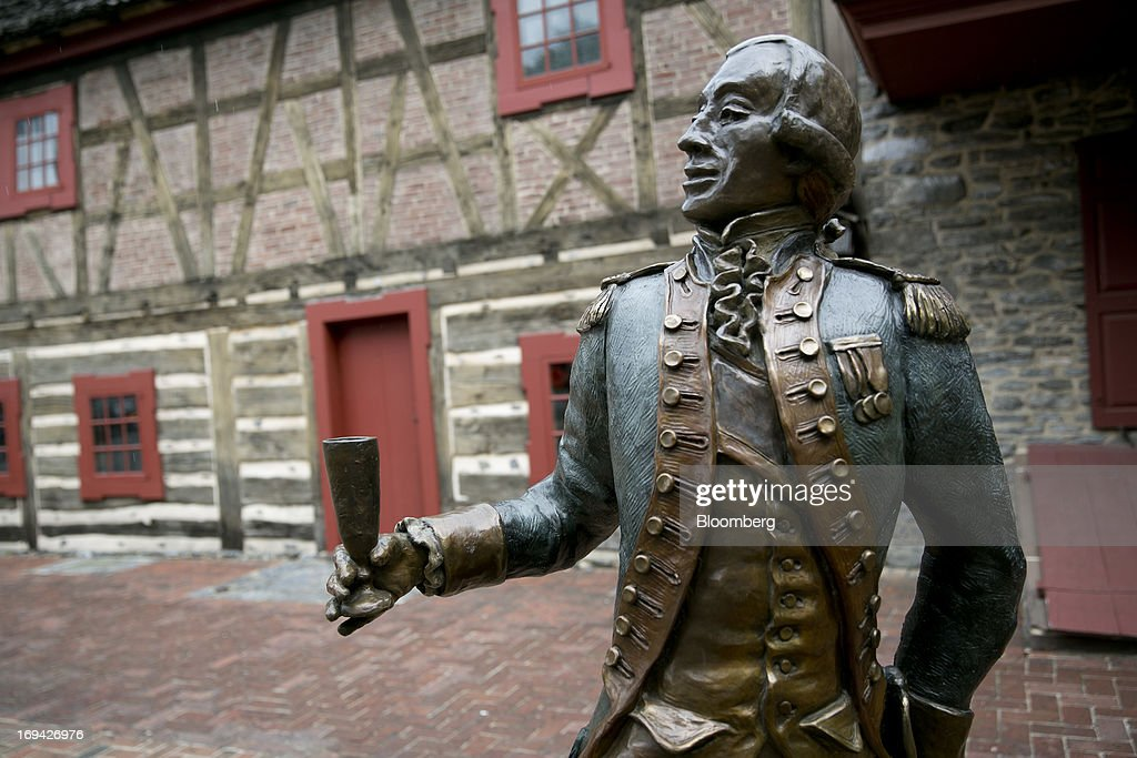 A statue of General Marquis de Lafayette stands outside the Golden Plough Tavern in York, Pennsylvania, U.S., on Thursday, May 23, 2013. BAE Systems Plc, which has a manufacturing facility in York, is deploying smaller suppliers to pressure U.S. lawmakers to speed up orders to modernize Bradley fighting vehicles, a move the company said may protect thousands of subcontractor jobs and keep a Pennsylvania assembly line open. Photographer: Andrew Harrer/Bloomberg via Getty Images