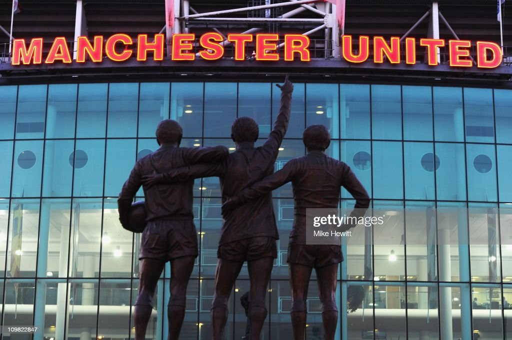 A statue of George Best Denis Law and Bobby Charlton standing outside Old Trafford home of Manchester United on March 2 2011 in Manchester England