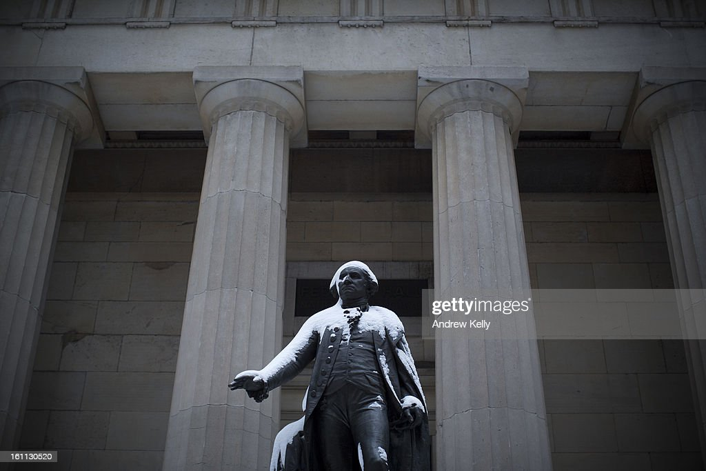 A statue of George Washington at Federal Hall is covered in snow following a major winter storm on February 9, 2013 in New York City. New York City and much of the Northeast received a foot or more of snow overnight. Heavy snow warnings are in effect from New Jersey through southern Maine.
