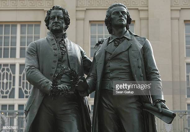 A statue of German writer Johann Wolfgang von Goethe and German poet and playwright Friedrich Schiller stands on June 4 2009 in Weimar Germany The...
