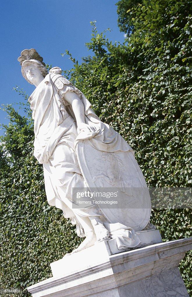 Statue Of Greek Goddess On Pedestal In Garden : Stock Photo