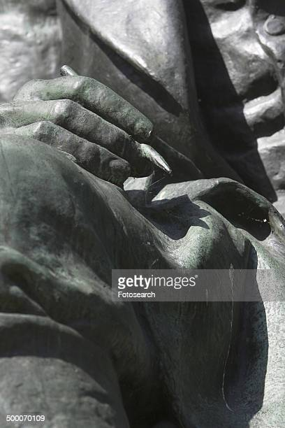 Statue of hand holding a pen