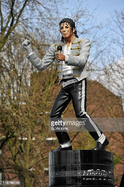 A statue of his friend Michael Jackson unveiled by Fulham's Chairman Mohamed Al Fayed stands on its podium before their English Premier League...