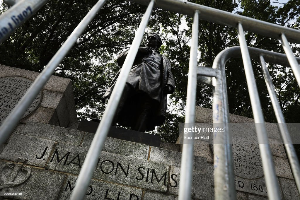 A statue of J. Marion Sims, a surgeon celebrated by many as the father of modern gynecology, stands along an upper Manhattan street on August 23, 2017 in New York City. Following the recent violence in Charlottesville, many politicians, activists and citizens are calling for monuments dedicated to Confederate-era and other controversial figures to be taken down. Many of Sims medical breakthroughs came from experimenting on black slaves without anesthesia.
