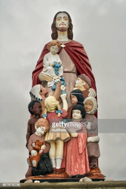 Statue of Jesus Christ embracing children from different cultural backgrounds in Mississauga Ontario Canada