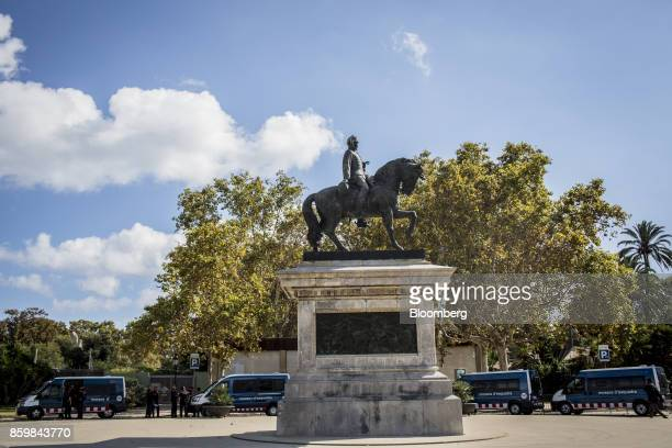 A statue of Juan Prim stands as Catalan Mossos d'Esquadra police prepare for the arrival of Carles Puigdemont Catalonia's president at the entrance...