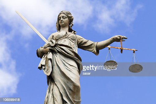 Statue of Justitia holding the Scales of Justice
