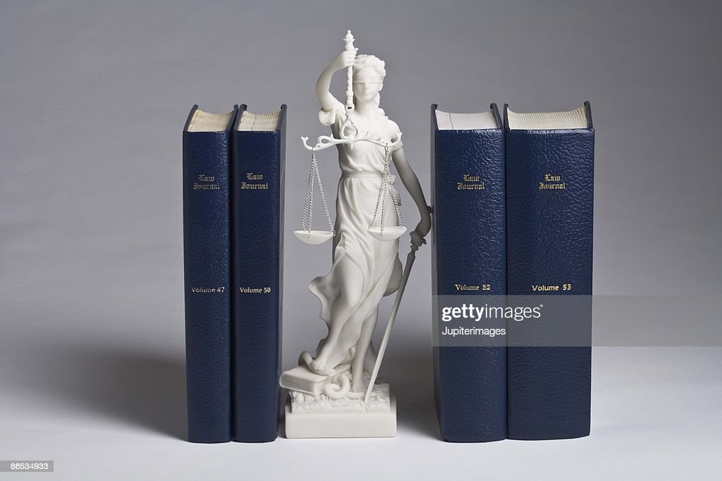 Statue of Lady Justice with law books