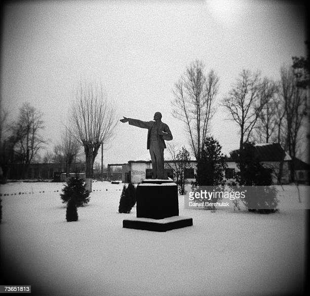 A statue of Lenin stands in the middle of a small park in the port of Chernobylb near the frozen river of Pripyat on January 29 2006 in Chernobyl...