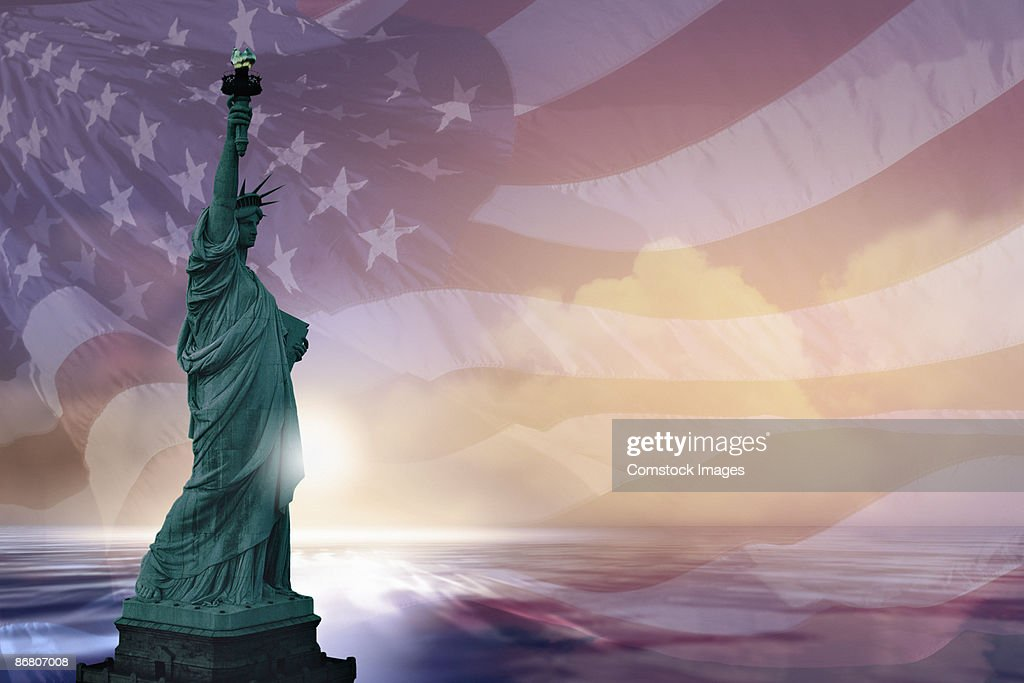 Statue of Liberty and american flag : Stock Photo