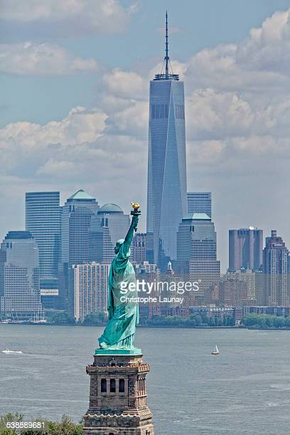 Statue of Liberty and Freedom Tower in Manhattan, New York City, New York, United States of America.