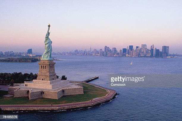 Statue of Liberty and skyline of New York City , USA