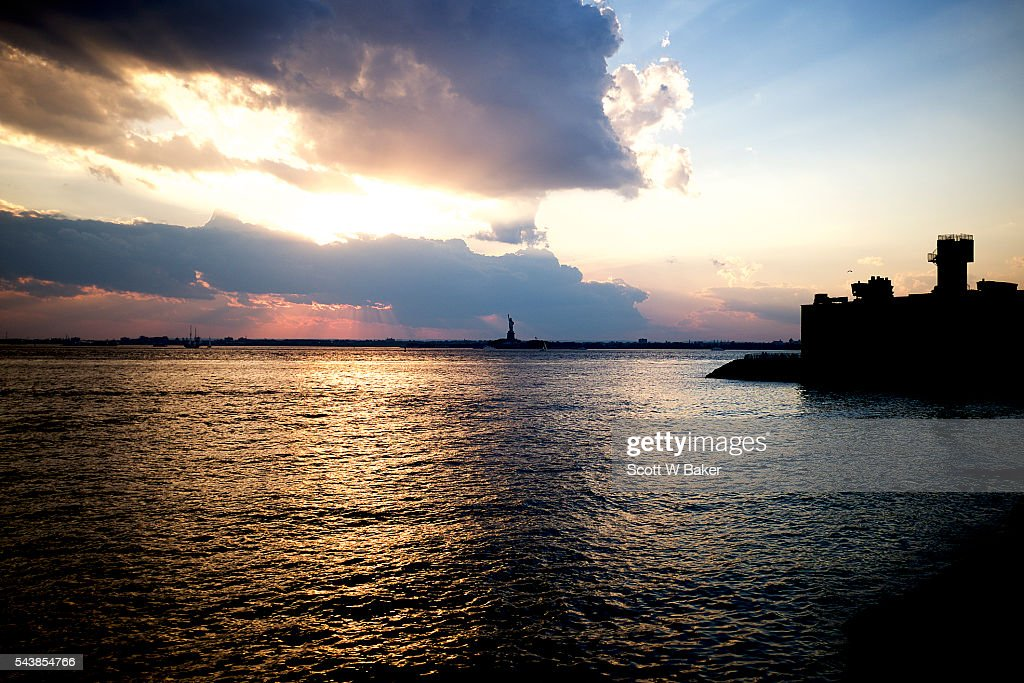 Statue of Liberty at the edge of Red Hook at Sunset.