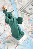 Statue of Liberty figurine on map