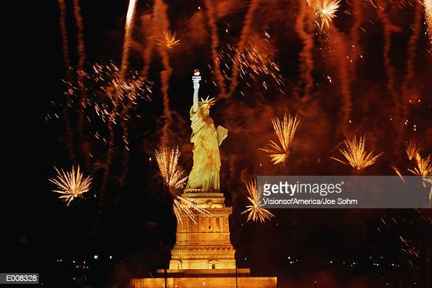 Statue of Liberty with fireworks exploding in background