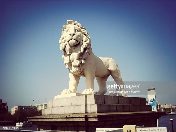 Statue Of Lion Against Clear Blue Sky