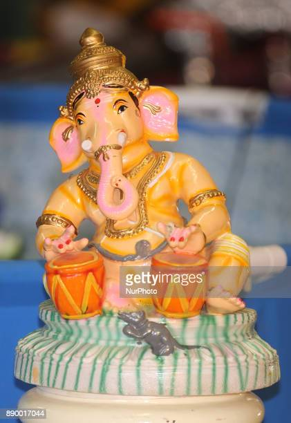 Statue of Lord Ganesh playing tabla drums at a Tamil Hindu Temple in Toronto Ontario Canada