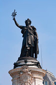 """Paris: Statue of Marianne. She embodies the French Republic and represents the permanent values of the republic and French citizens: """"Liberty, equality, fraternity""""."""