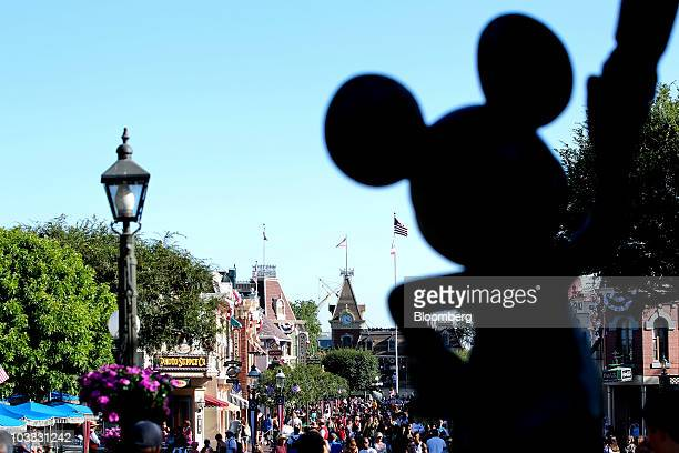 A statue of Mickey Mouse stands in front of Main Street USA at Walt Disney Co's Disneyland amusement park in Anaheim California US on Thursday Aug 5...