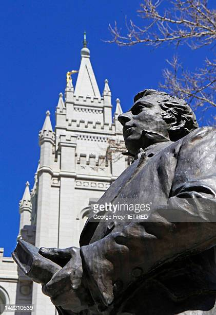 A Statue of Mormon Church founder Joseph Smith and the historic Mormon Salt Lake Temple are shown here during the 182nd Annual General Conference of...